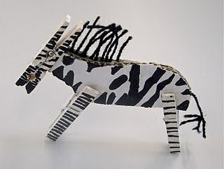 Kids Learn How To Do Handicrafts A Zebra Out Of Cardboards And Pegs