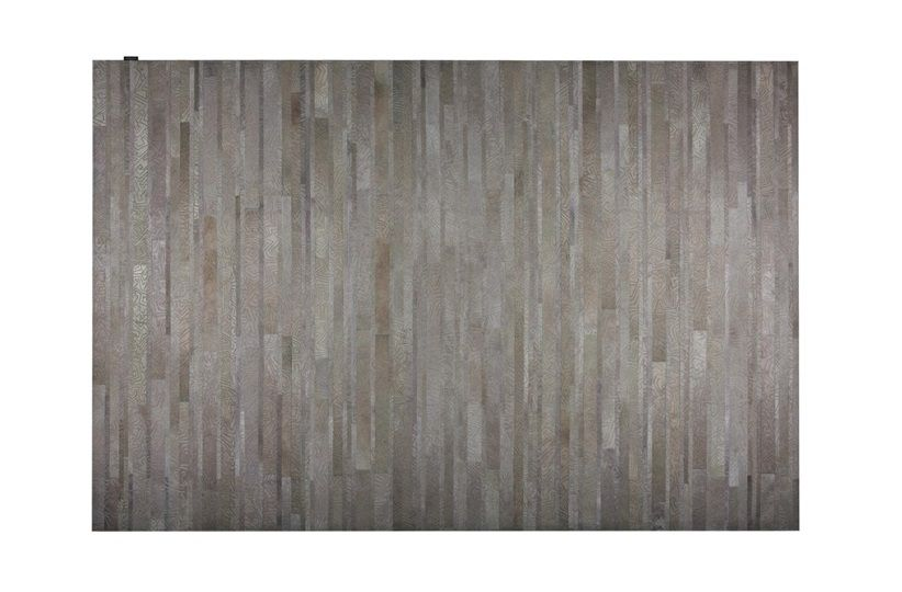 Give any room a beautifully textured foundation with this Vektor hide, rendered in a neutral hue. The traditional motif of the skin is reworked with geometric detailing to create a unique design visual for your floors.