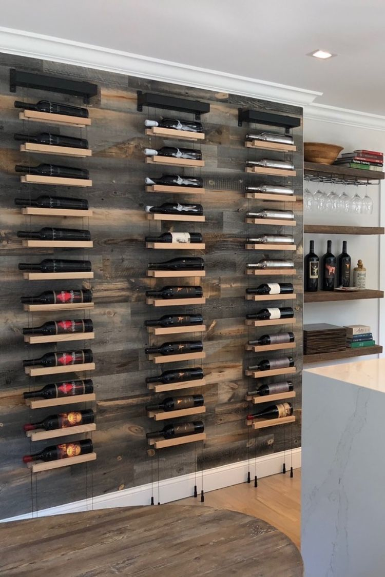 Buoyant wall mounted cable based wine racks will decorate