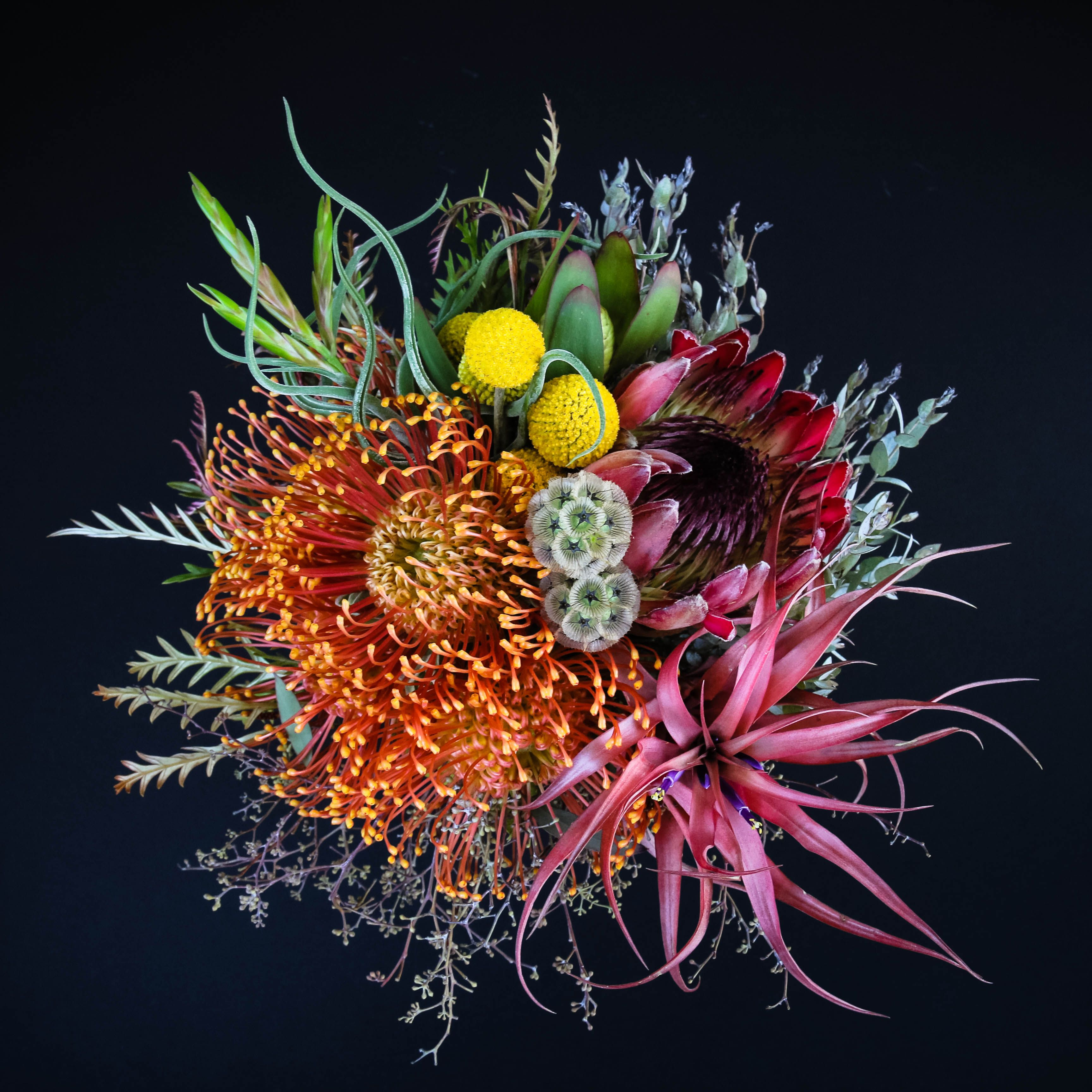love, love, love this funky bridemaid's bouquet. I would replace some of the magenta with purple though and maybe a bit more blue.