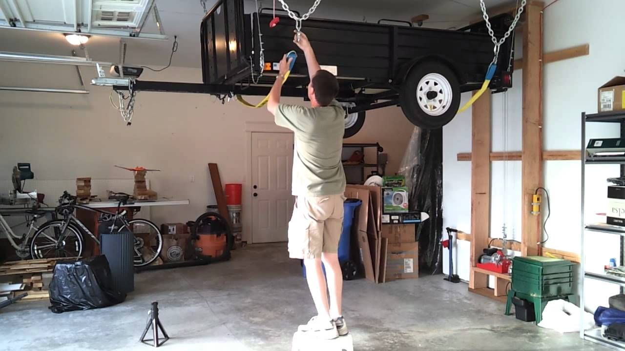 Hang my utility trailer from the garage ceiling. Idée