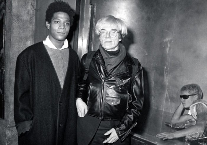 "Jean-Michel Basquiat and Andy Warhol at Area nightclub, for the ""Gifts for the City of New York"" benefit for the Brooklyn Academy of Music's New Wave Festival, November 1984."