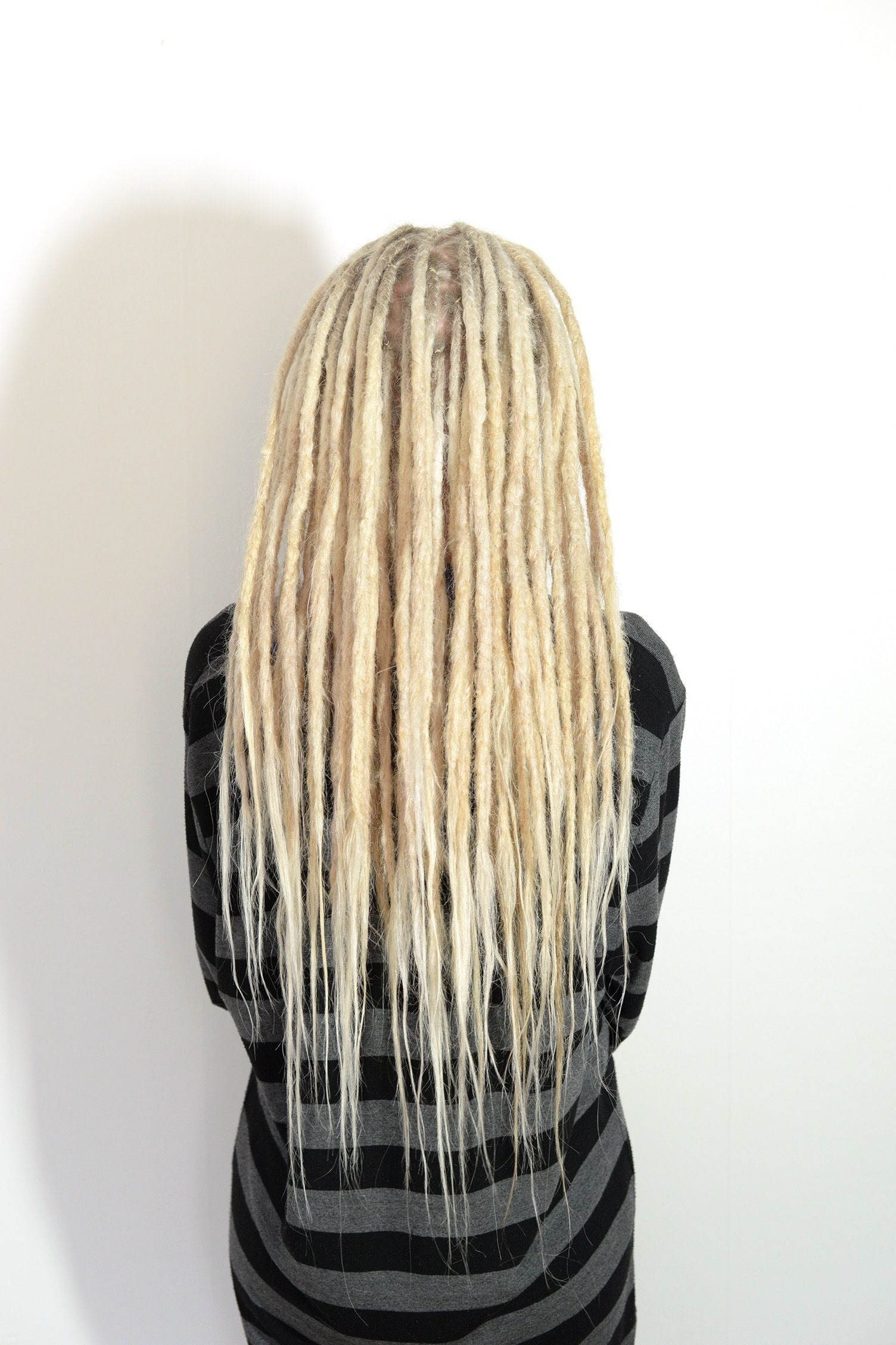 This is fanny, she came to me to get dreadlocks done, she had been thinking about it for a while and now finnaly. Her dreads are made on her own hair and also human hair that I used to add length to her dreads. Love the look of these blond dreadlocks.