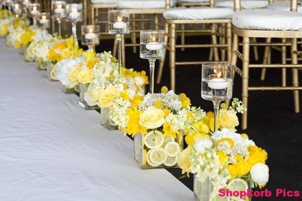 Flowers along wedding aisle runner