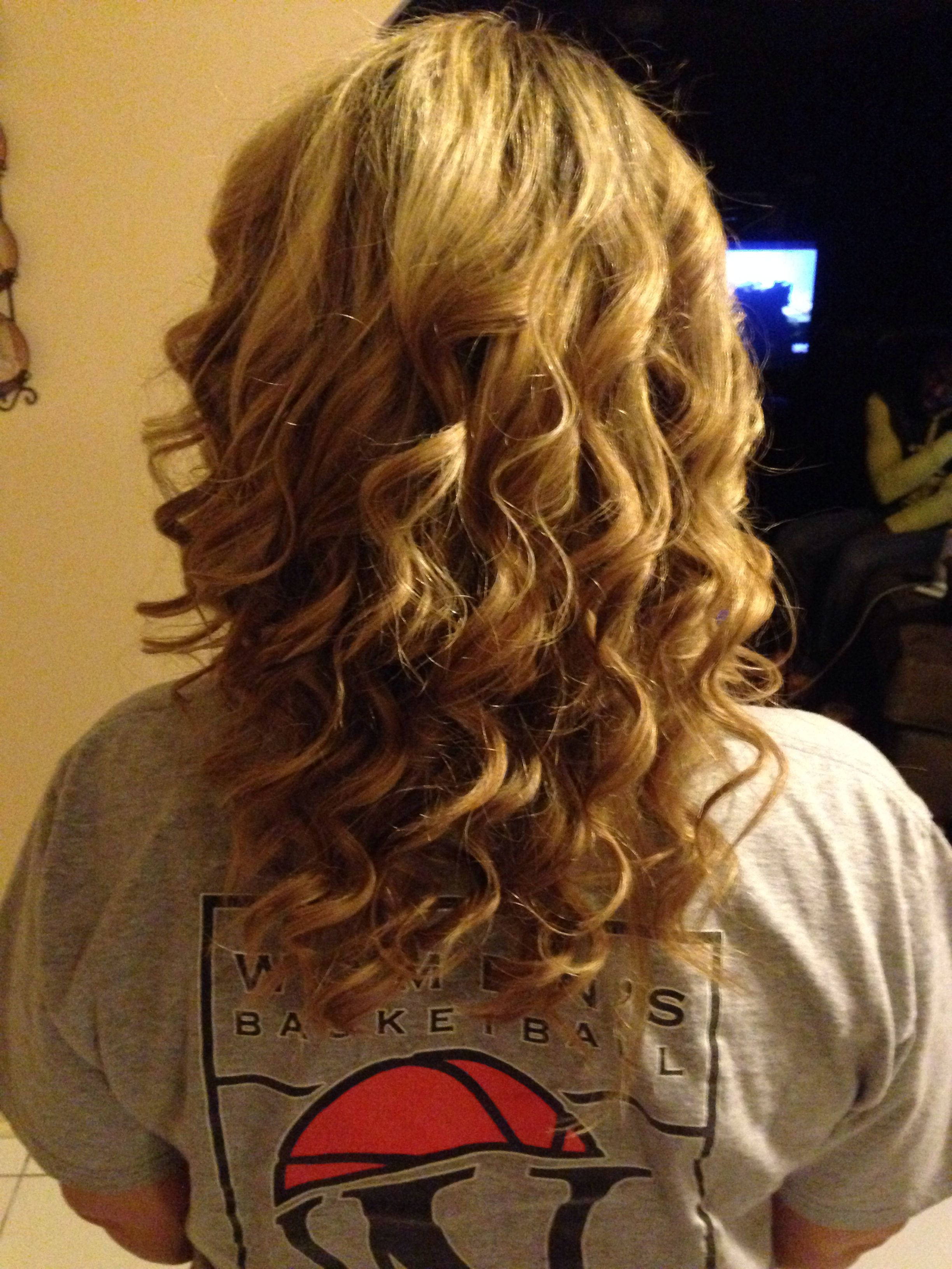curled hair by a wand. curly hair for medium length. prom