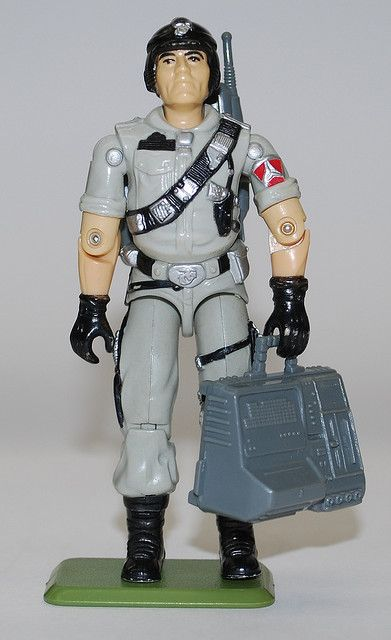 """The action figure for Mainframe, a military computer specialist, with his bulky 1980s-era """"laptop."""" From the 3 3/4"""" line of """"G.I.Joe"""" toys."""