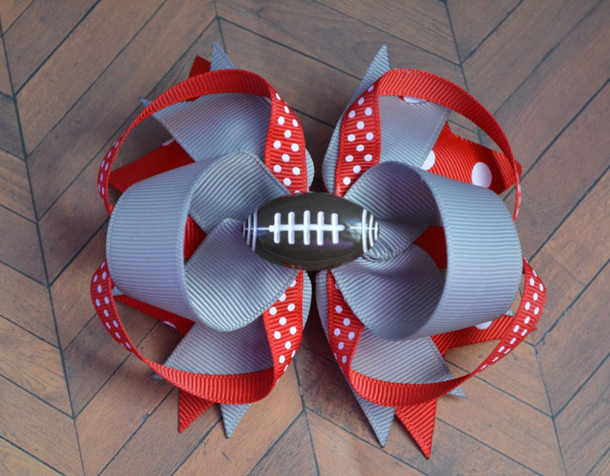 A personal favorite from my Etsy shop https://www.etsy.com/listing/247998874/ohio-state-hairbow-red-grey-white