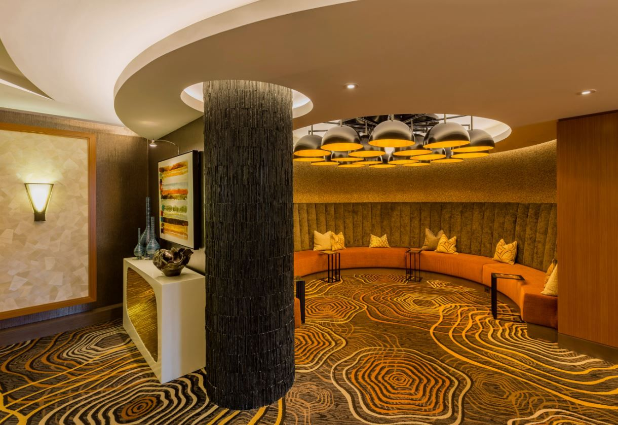 We love for our projects to tell a story, and this #rotunda and entrance of the #cyberlounge reveals a #carpet that shows a rippling motion like water. This #circular motion again compliments the curvy #ceiling and #spherical light fixtures.