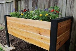 How to Make a DIY Raised Planter Box is part of Raised planter boxes, Planter boxes, Raised planter boxes plans, Raised planter, Diy planter box, Planter box plans - How to Make a DIY Raised Planter Box Planter boxes are a classic Springtime project and we've always wanted to design and build one in our own style  At the time of writing this, Jaimie is 8 months pregnant with our second child   which makes gardening   difficult  So, doing a DIY Ra