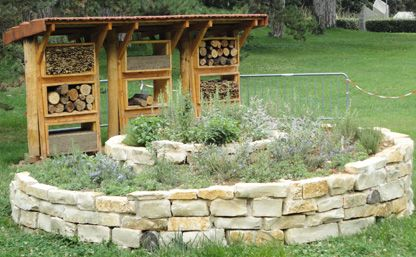 A spiral flower bed and a habitat for wild bees to increase biodiversity & plant pollination in Lyon, France.