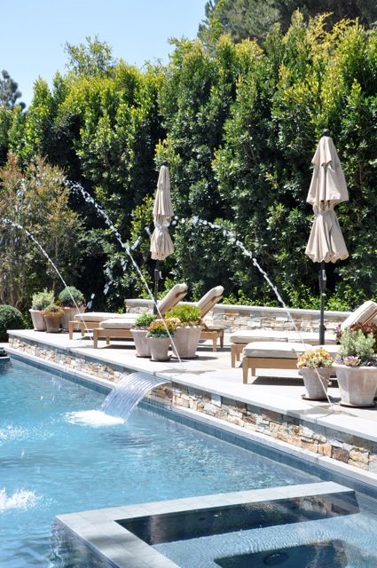 Waterfall and Fountains with lovely poolside deck