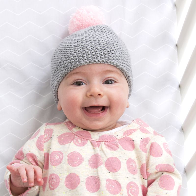 8de8973ecce Red Heart Baby Hugs Newborn Cozy Cap - how to knit baby hats - easy free knitting  patterns for baby items - knitting tutorial for an infant or toddler ...