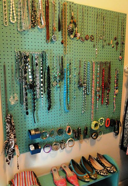 Peg board from Lowe's painted a fav color with hooks to hang necklaces and braclets. I need to do this...