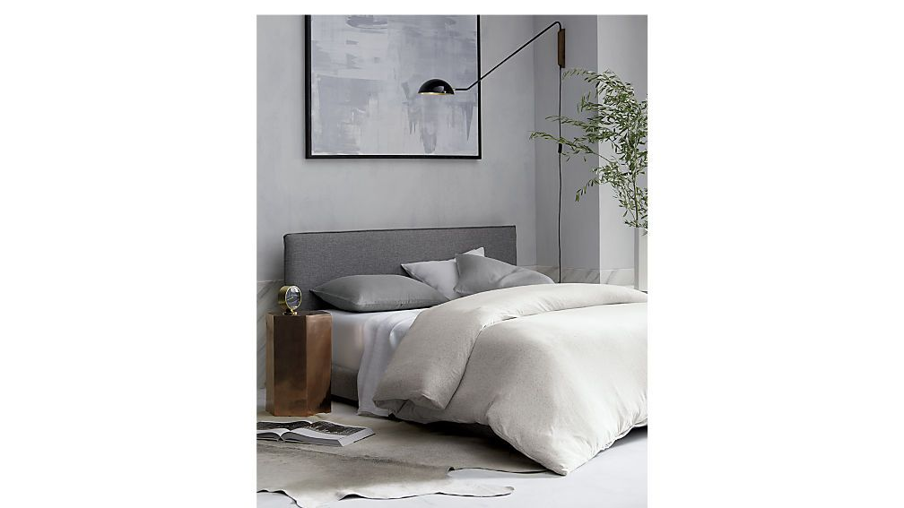 3eb84b66c021 Shop facade grey upholstered bed. Clean box bed silhouette sleeps  sophisticated in salt-and-pepper tweed.