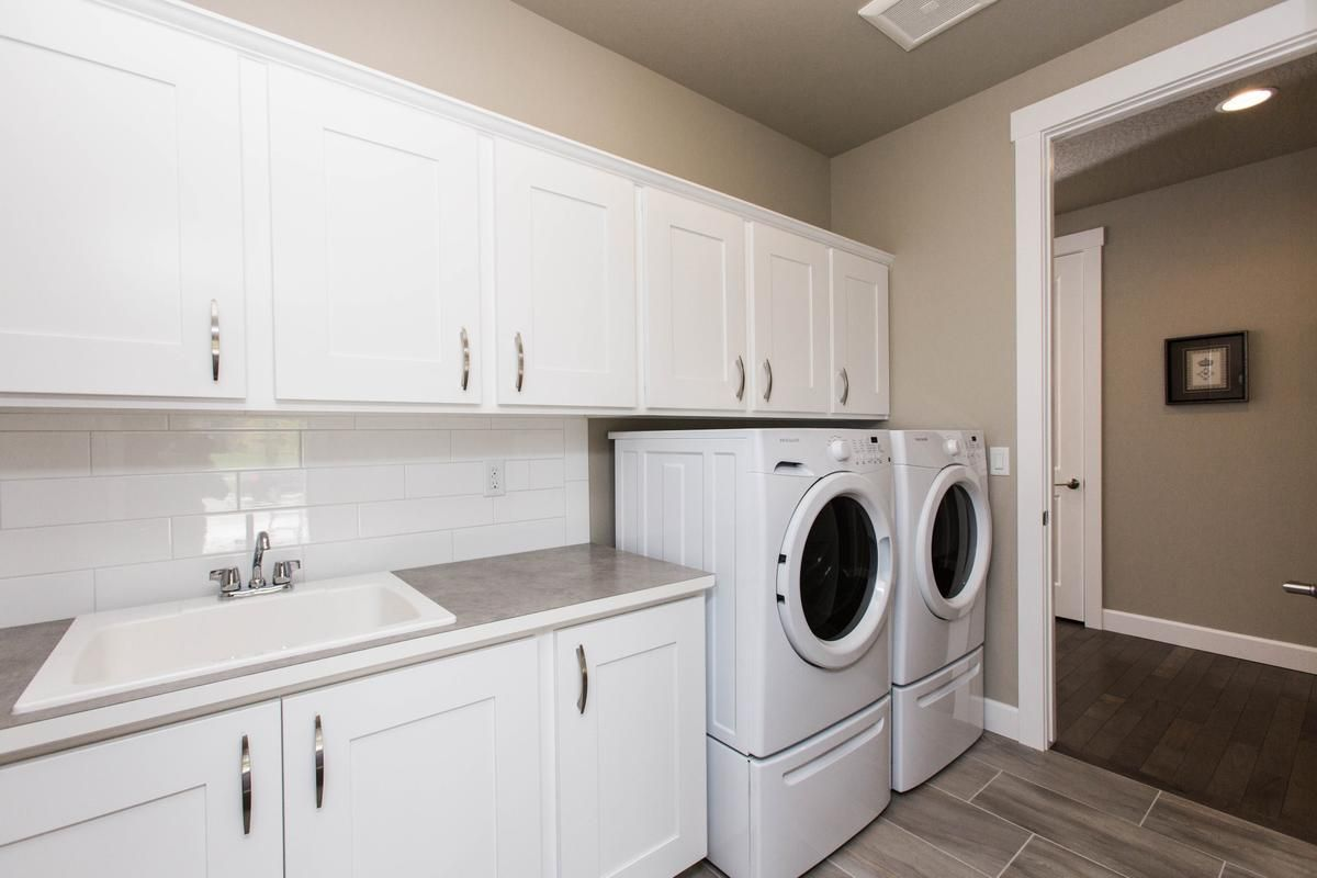 Laundry With Full Height Back Splash Sink In Lower Base Cabinet