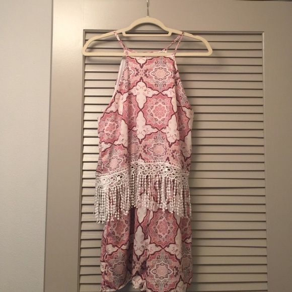Bohemian fringe romper Elastic waistband, button closure on back. Very cute and light for summer. From Charlotte Russe juniors size large! Charlotte Russe Dresses