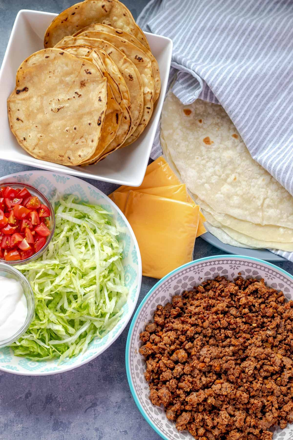 All of the ingredients to make homemade Crunchwrap Supremes. Get the full recipe at www.whippeditup.com  #crunchwrapsupreme #tacos #tacotuesday #mexican #homemadetakeout #eatrealfood #whippeditup #recipe #copycatrecipe