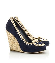 Tory: Natasha High Wedge`The Natasha High Wedge combines the best of both worlds: a sophisticated suede silhouette, juxtaposed with rough-hewn details. Natural raffia trim and covered heel lend a bohemian vibe to this leg-lengthening style. It's an ideal pair to add an eclectic cool touch to everything, from skinny cropped jeans to boldly printed dresses and skirts.