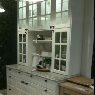 Love this kitchen wall. Upper lighted cabinets are key.