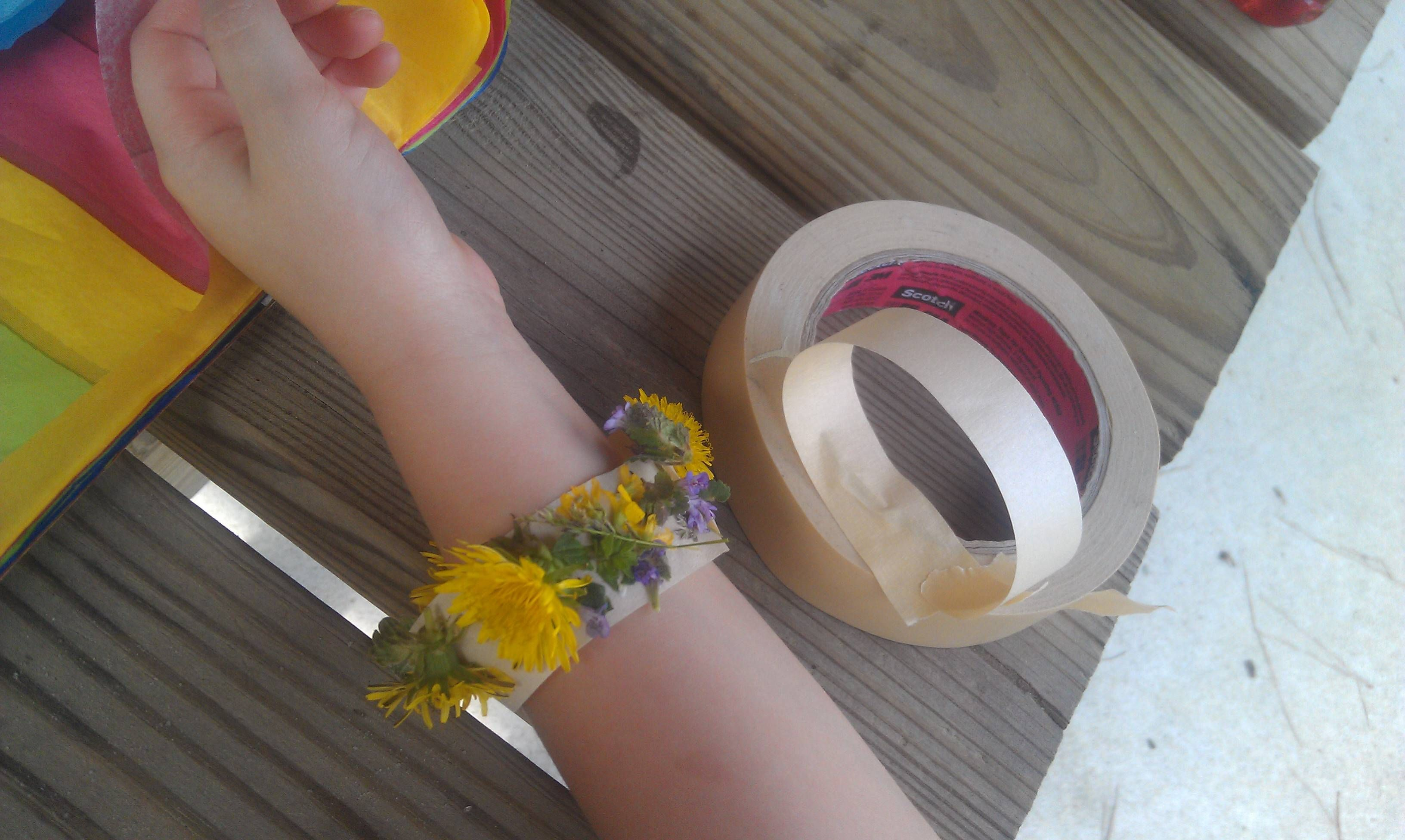 Little ones can collect flowers and stick them to their reversed tape bracelets! Nature fun!