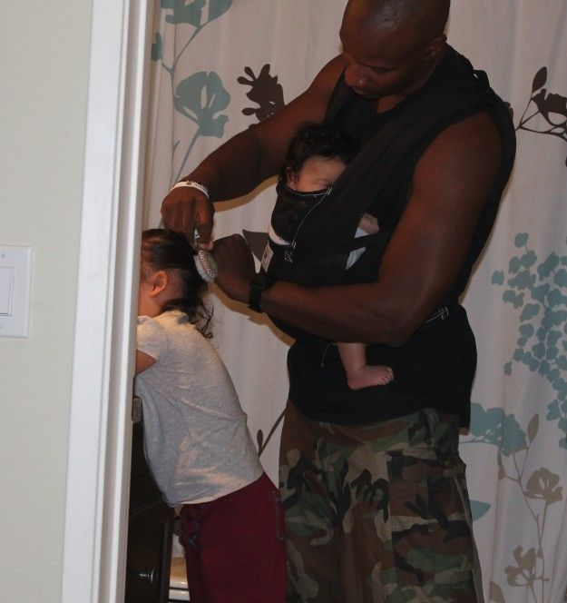 He's a pro at getting the kids ready for school. | 16 Awesome Things Modern Dads Do