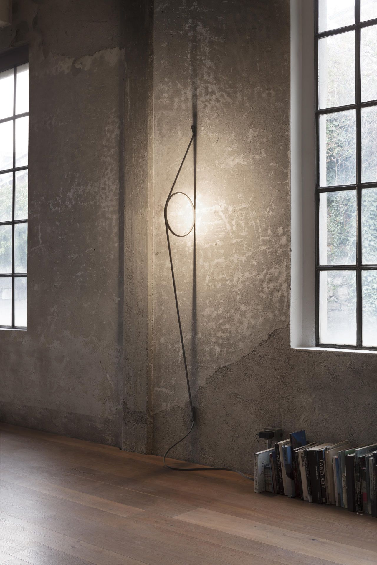Illuminazione Led A Muro wirering is a sculptural light that hovers between a wall