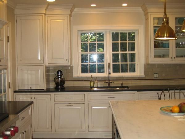 Best Cream Kitchen Cabinets With Black Granite Countertops 400 x 300