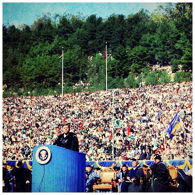 "President John F. Kennedy delivers address at Charter Day, March 23, 1962. In his address to a packed Memorial Stadium, President Kennedy spoke about his hopes for cooperation between the Soviet Union and the United States in space exploration and how such shared ""pursuit of knowledge"" might bring a shared ""pursuit of peace."" He also remarked that with so many members of his cabinet being Cal graduates, ""the New Frontier owes as much to Berkeley as it does to Harvard University."""