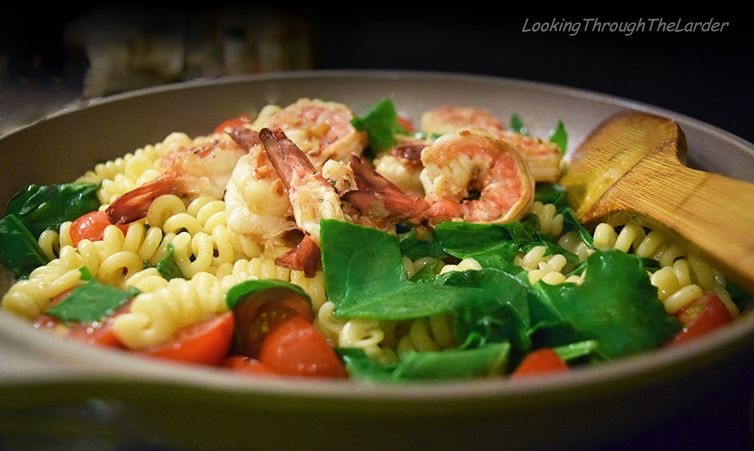 A simple and quick pasta recipe with succulent shrimp, bursting cherry tomatoes and lemony tang.  http://www.lookingthroughthelarder.com/bucatini-with-shrimp-baby-spinach-cherry-tomatoes/