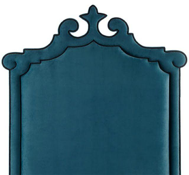 Headboard with a Moorish cut out design.