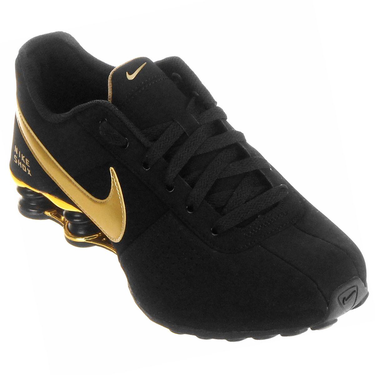 a77f95ed999 Tênis Nike Shox Deliver Dourado