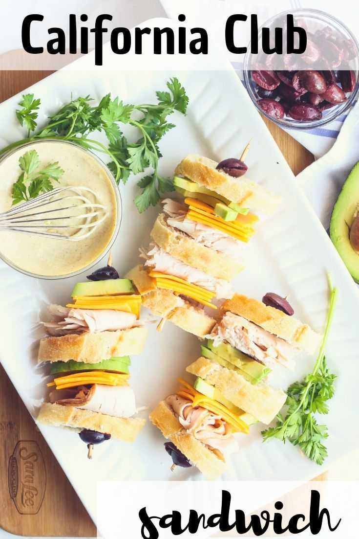 a quick & easy party recipe that will wow friends and family? Check out this California Club Sandwich! With layers of turkey, avocado slices, and marinated olives, it's the perfect appetizer or main dish for the big game or anytime! Serve with delicious spicy mustard aioli for dipping.