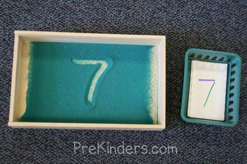 Another sand writing activity. Children practice writing numerals in ...