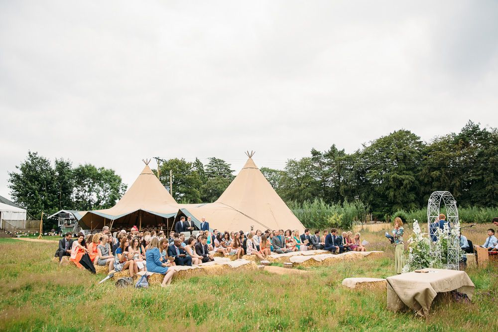 Image by Red On Blonde Photography. - A Rustic And Bohemian Tipi Wedding With A 'Dentelle' Jenny Packham Wedding Dress And A White Bouquet With A Mobile Bar By Red On Blonde Photography.