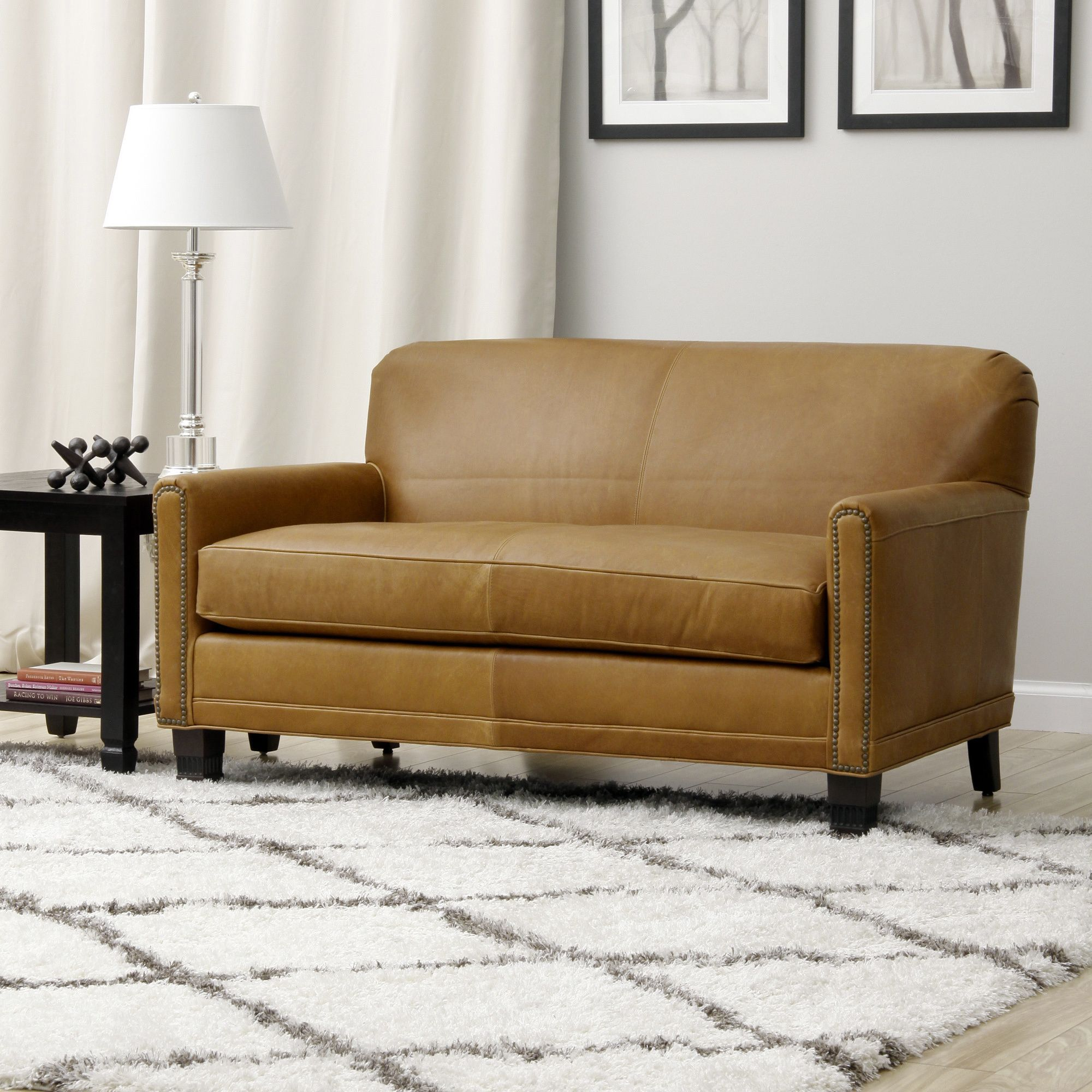 Smooth Caramel Colored Leather And Sturdy Hardwood