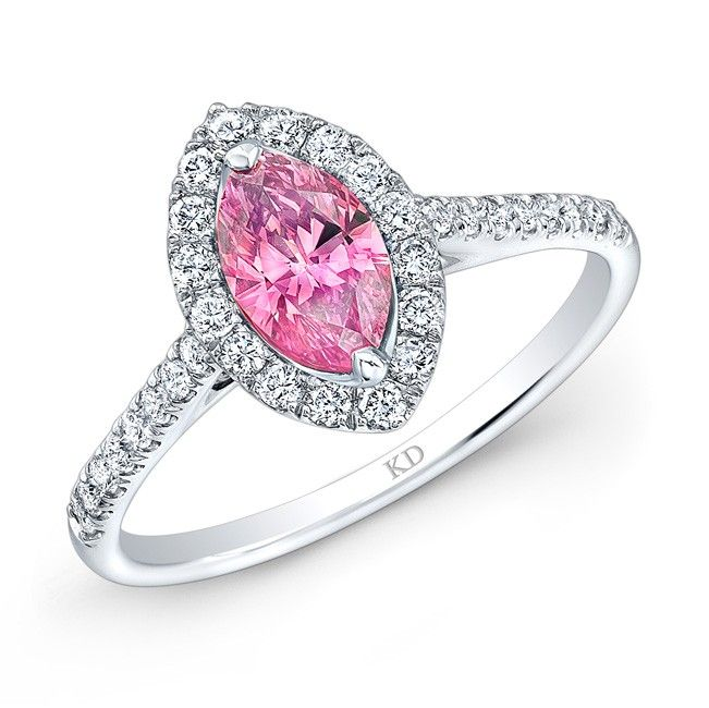 18K WHITE GOLD CLASSIC DIAMOND RING FEATURING PINK COLOR ENHANCED MARQUISE CENTER DIAMOND TOTALING 0.52 CARAT AND SURROUNDED BY ROW OF ROUND WHITE DIAMOND
