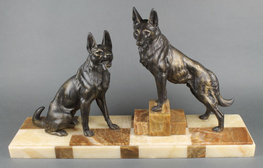 "Lot 177, L Carvin, an Art Deco bronze and marble figure group of 2 German Shepherds, raised on a 2 colour marble base 17""h x 28""w x 7""d, est £200-300"