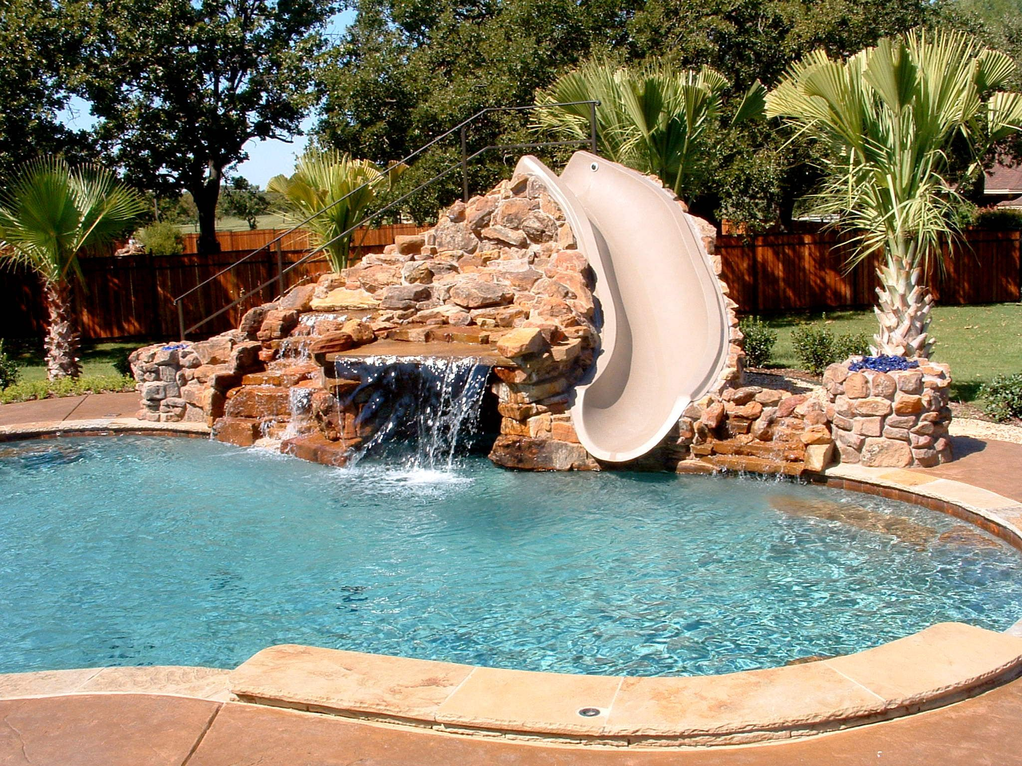 Swimming pools pool custom features beach entry slide bench additions swimming pool Beach entry swimming pool designs