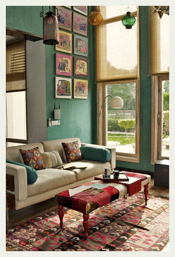 Bright boho/eclectic living space. Love the teal wall, Morrocan ...