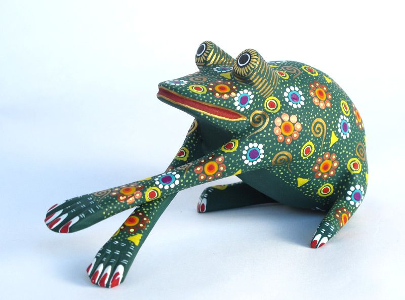 Green wooden frog hand painted in Oaxaca, Mexico