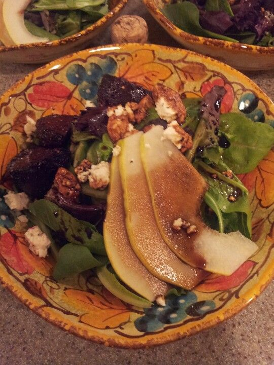 Roasted beet and pear salad with pomegranate balsamic reduction and feta peppered cheese.