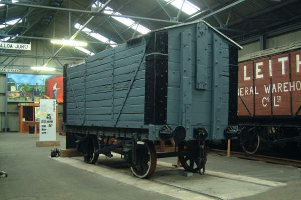 Robert Hutchison Covered 10 ton Grain Hopper Wagon No. 5 -   The vehicle and Leith General Warehousing wagon no.120 also in the collection illustrate a Scottish variant of a wooden bodied bulk grain hopper wagon.  Although this looks like a covered van, the internal floor slopes steeply from each end towards the centre, and there are hopper doors at the centre for discharging the grain.