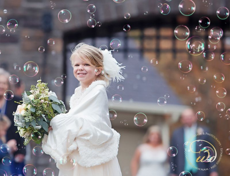 Bubbles are great alternatives to flower petals for an outdoor ceremony. Castle Pines - Home of Chestershire Castle Outdoor Event Venue Luray, Tn 38352 castlepinesfarm.com #castlepinestn #tncastle #castlebride #tnweddingvenue #castlewedding #flowergirl