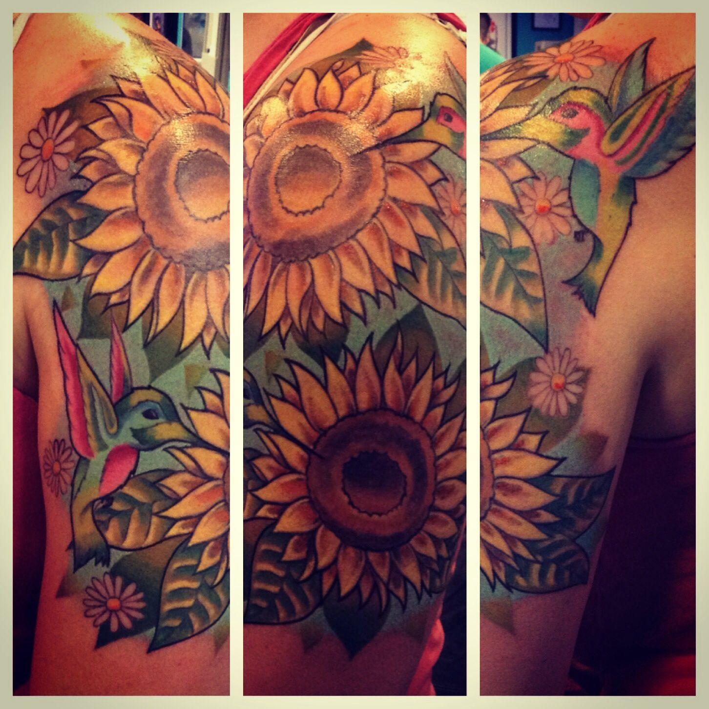 All views of a custom sunflower and hummingbird tattoo I did