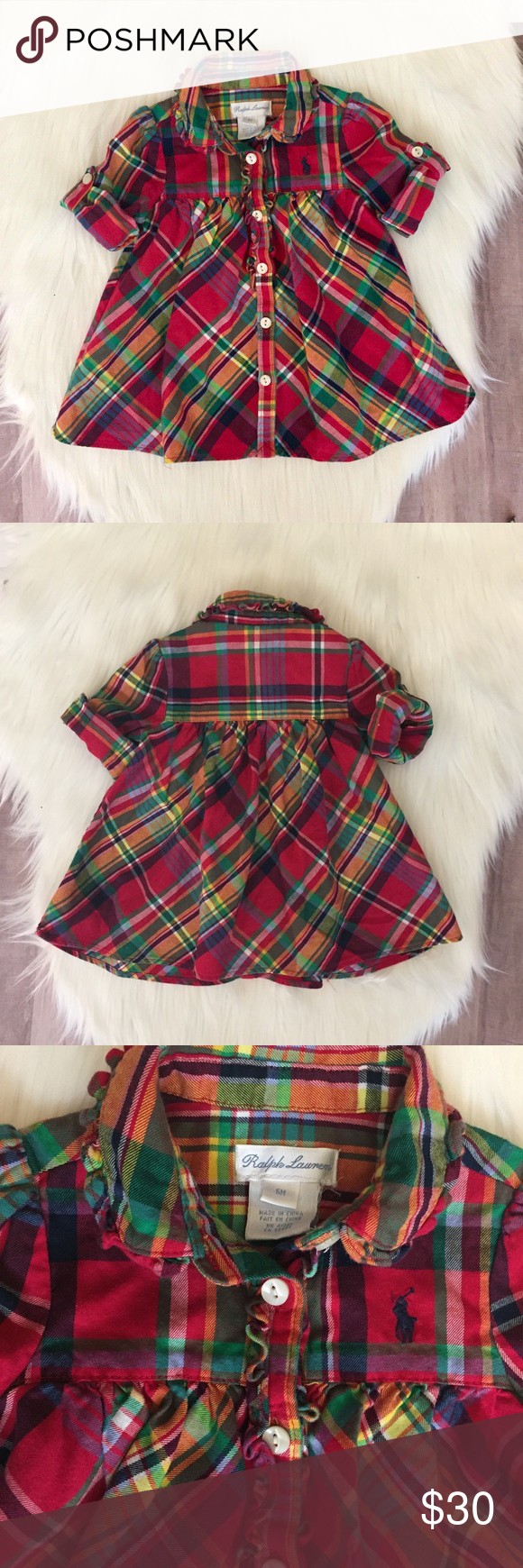Ralph Lauren Baby Girl Plaid Dress Excellent like new condition, worn once. Adorable Ralph Lauren dress for baby girl. Buttons all the way down the front. Sleeves can be rolled up and secured with a buttoned strap or left down. Cute ruffled detail around collar and buttons. So cute 💕💕💕 Ralph Lauren Dresses