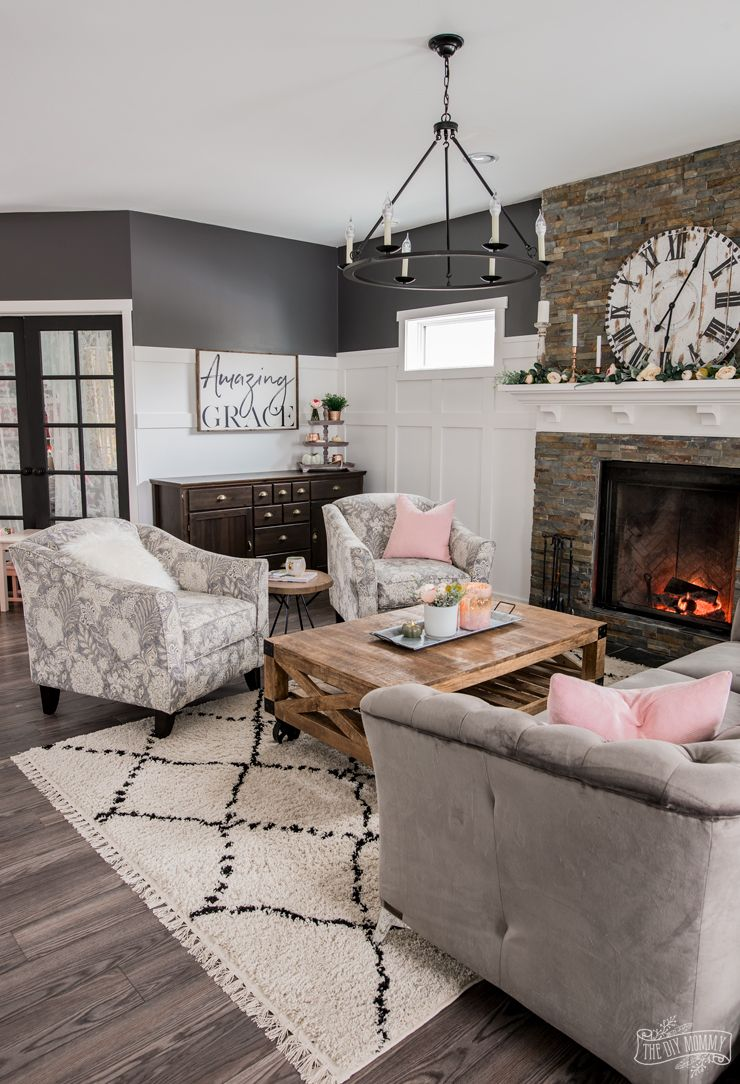 A cozy rustic glam traditional living room in black white grey