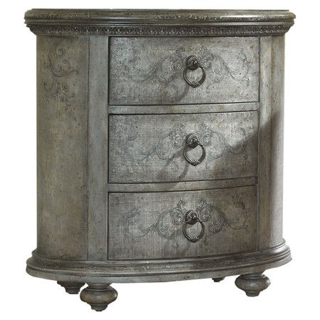 Three-drawer chest with hardwood framing.    Product: Chest   Construction Material: Hardwood solids and resin...