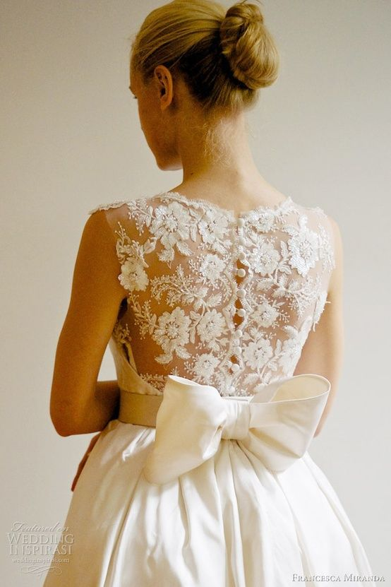 Wedding dress with a floral lace back