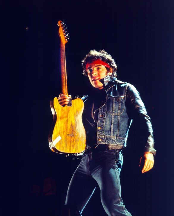 Bruce Springsteen performing at live gig