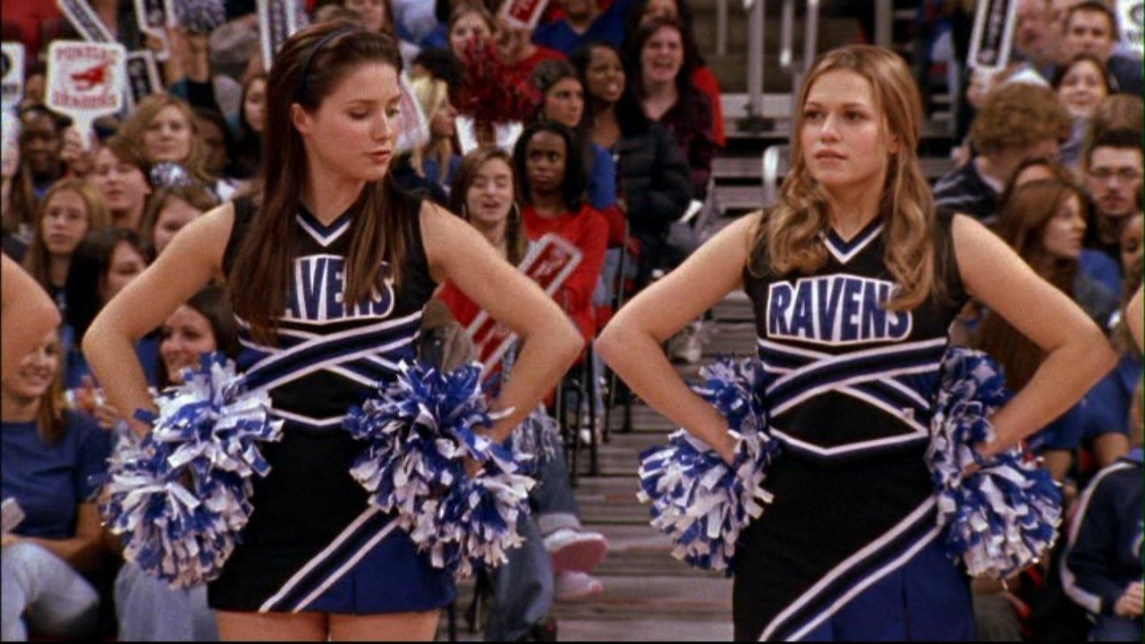 The Tree Hill Ravens black cheerleader uniforms and pom-poms
